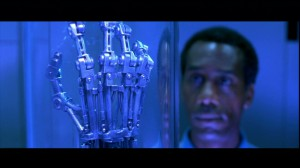 Miles Dyson gazes at the Terminator's hand