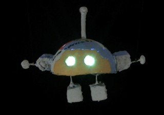 Robot from batteries not included movie 1987