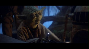 Yoda fighting R2D2 in Star Wars: The Empire Strikes Back