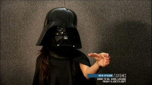 Selena Gomez dressed as Darth Vader force chocking some guy