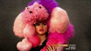 Selena Gomez wearing a big weird pink dog hat
