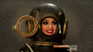 Selena Gomez wearing a deep sea diving helmet