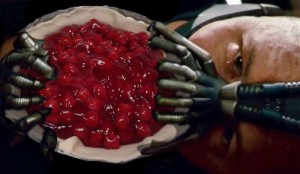 Tom Hardy as Bane in the Dark Knight Rises eating a Cherry Pie, looking like Goatse