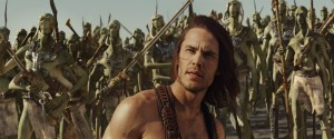 Taylor Kitsch as John Carter with Tharks