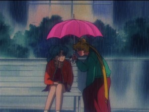 Sailor Moon episode 149  - Usagi offers Fish Eye an umbrella