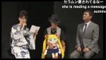 Kotono Mitsuishi, Toru Foruya and Osa-P reading a letter from series creator Naoko Takeuchi at Sailor Moon 20th anniversary event