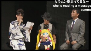 Kotono Mitsuishi, Toru Foruya and Osa-P reading a letter from series creator Naoko Takeuchi at Sailor Moon 20th anniversary event