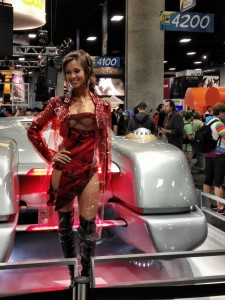 Total Recall's 3 breasted woman Kaitlyn Leeb posing in front of a car