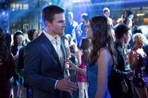 Stephen Amell as Oliver Queen and Willa Holland as Thea Queen in Arrow