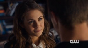 Willa Holland as Thea Queen in a schoolgirl uniform in Arrow